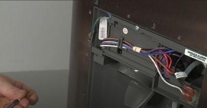 reinstalling the water dispenser line in refrigerator